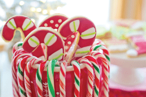 candy canes and cookies in a jar