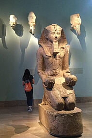 Girl in museum with Egyptian art