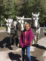 Girl near horses and carriage