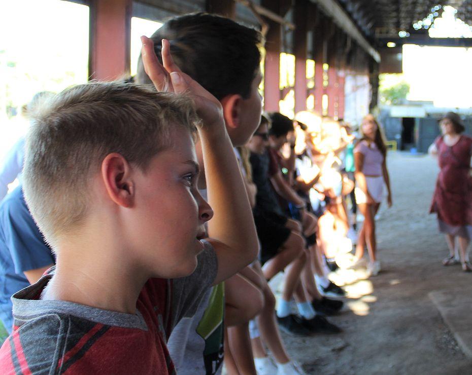 boy raising hand at Sloss Furnaces