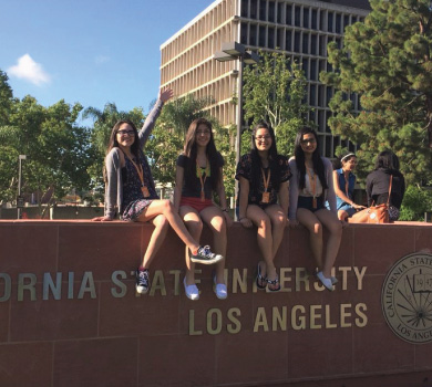 Girls at Cal State LA Sign